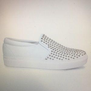 Steve Madden white sneakers.